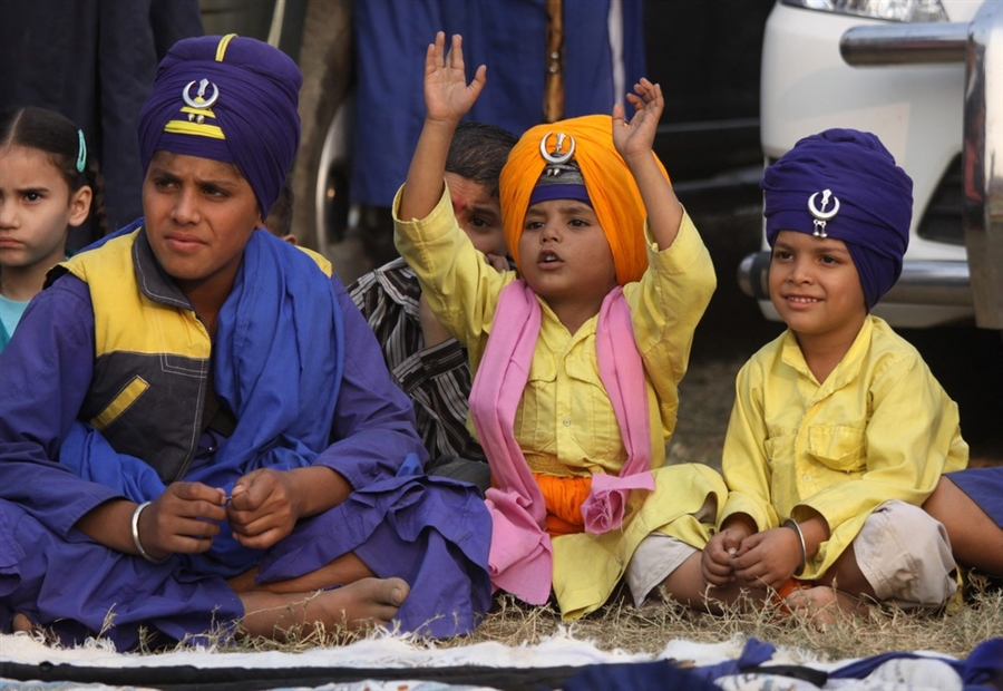Sikh children watching Gatka